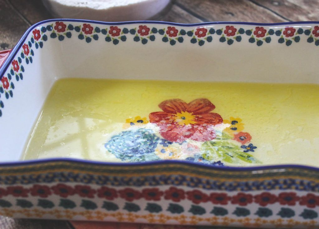 Melted butter in baking dish.