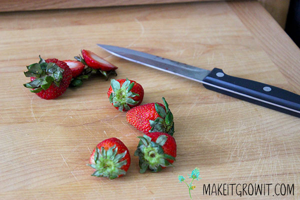 Slicing strawberries.