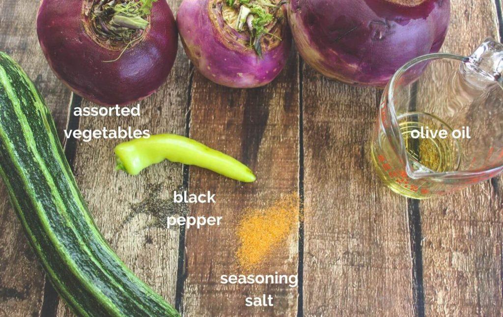 Ingredients for making roasted garden vegetables: assorted vegetables, olive oil, black pepper, and seasoning salt.